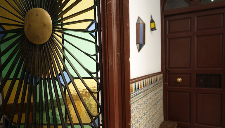 stained glass and tile walls at center