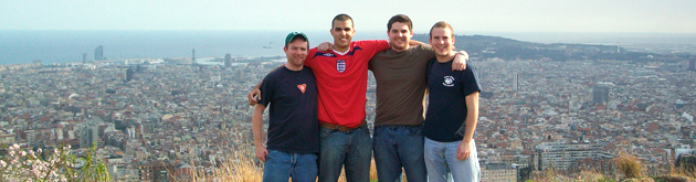 Male students on hill overlooking Barcelona