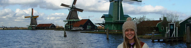 IES Abroad Amsterdam student with windmills.