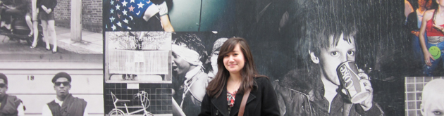 Student in front of Soho Construction Wall