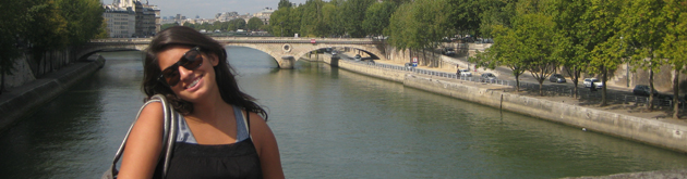 A student on the Seine river in Paris