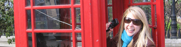 Student in phone booth in London
