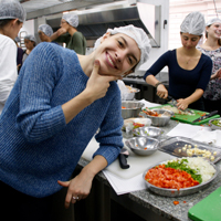 student posing during a cooking class in Argentina