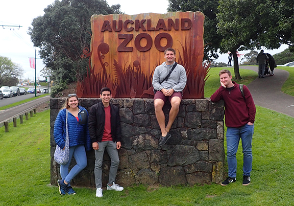 Students standing at the entrance to the Auckland Zoo