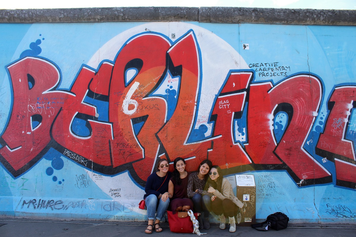 "IES Abroad student group poses in front of ""Berlin"" graffiti"