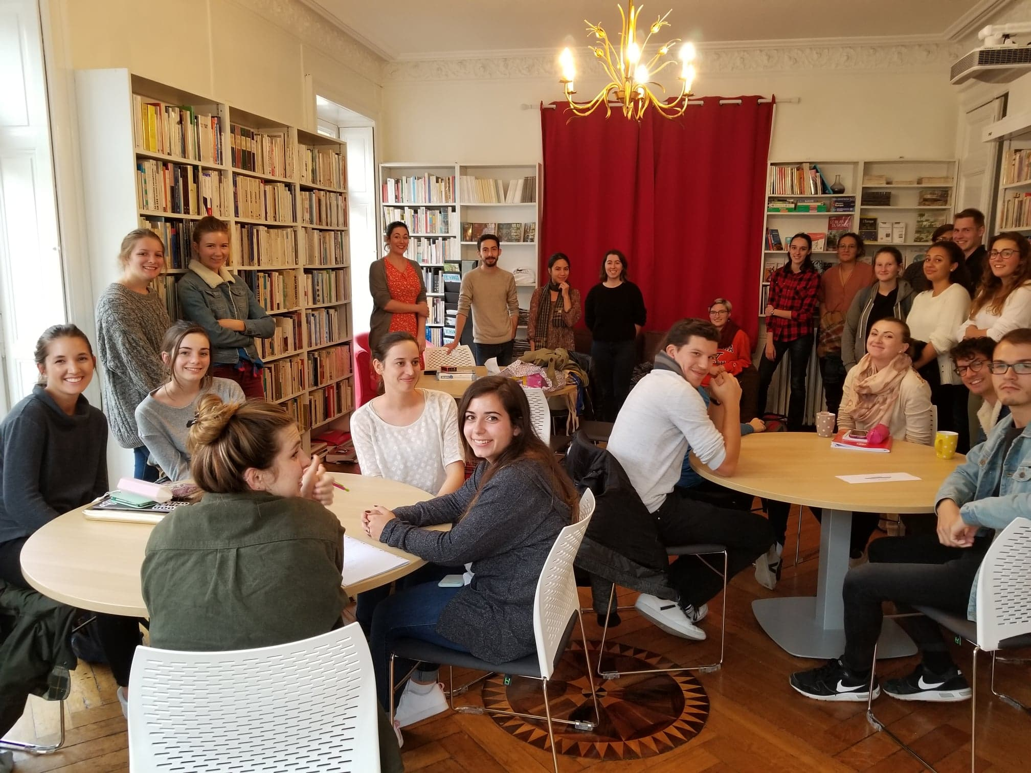A group of French and American students at IES Nantes Conversation club in the library