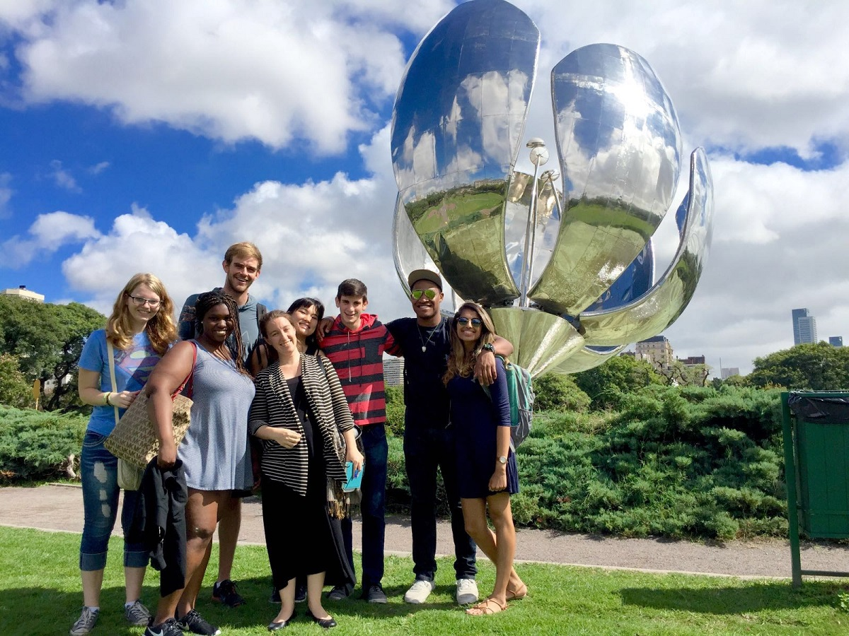 students standing in front of floralis generica