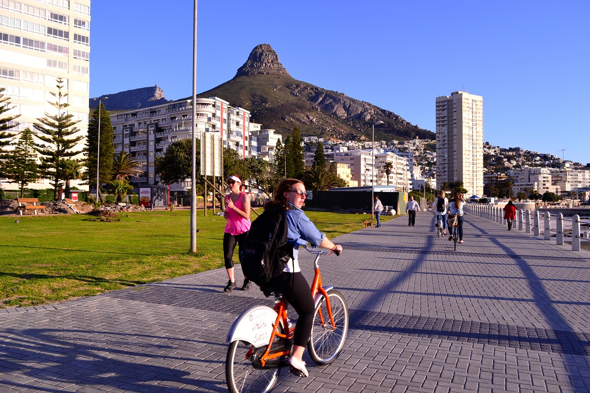 student biking on path in Cape Town