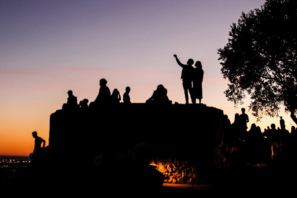 silhouette of students at bunkers in barcelona at sunset