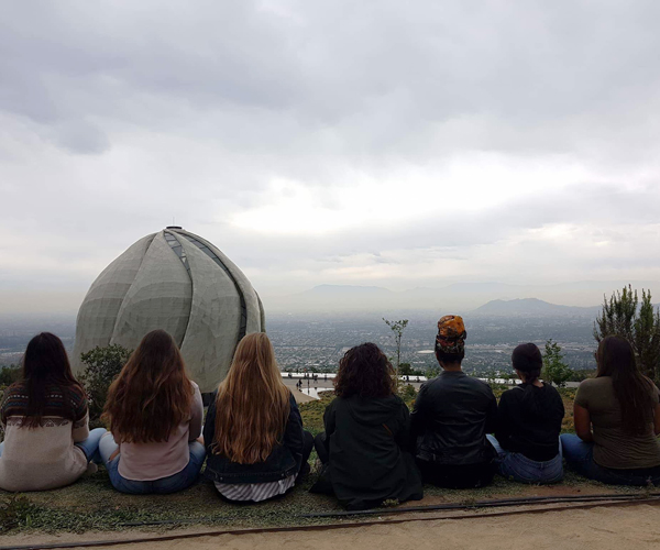 spanish study abroad students sitting facing bahai temple in sanitago