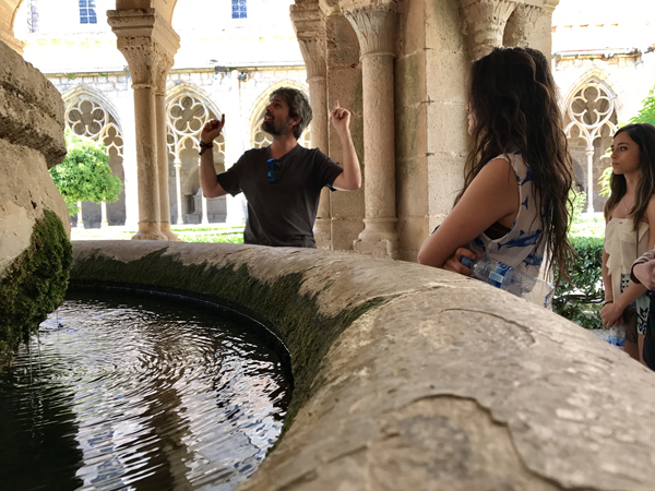 Faculty-Led Study Abroad program with students around Fountain