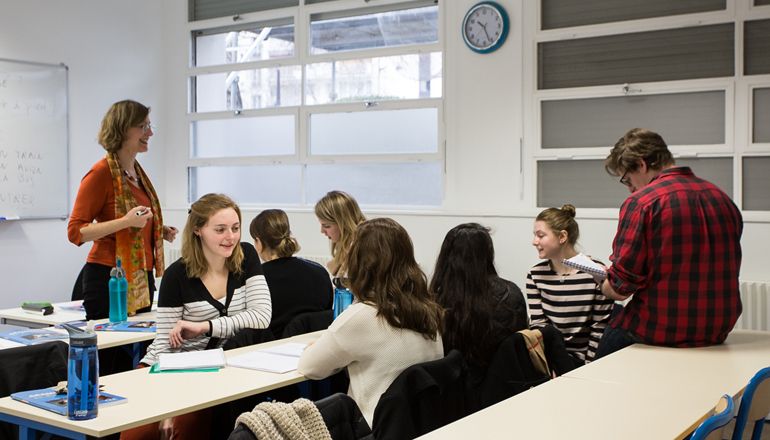 professor working with students in a classroom at the Paris BIA Center