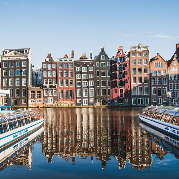 Photo of houses and boats on the canal in Amsterdam