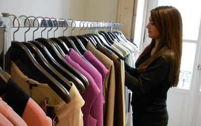 IES intern in Milan adjusting a rack of clothing