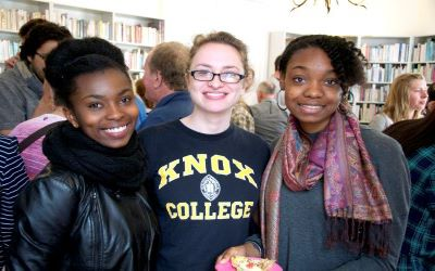 A group of young alumnae smiling at the camera during a reception in the Nantes Center in France