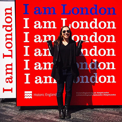 "Student in front of ""I Am London"" sign"