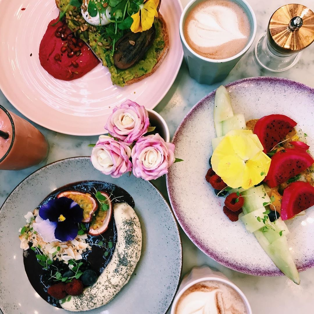 colorful brunch table with plates of food