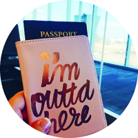 "passport and passport cover that reads ""i'm outta here"""