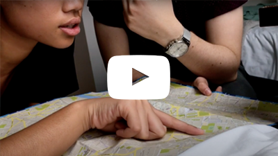 Video clip of students looking at a map