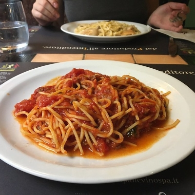 a plate of pasta with red sauce