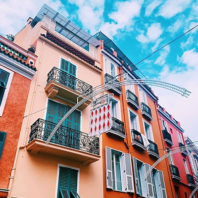 colorful pink architecture cast against a blue sky in barcelona