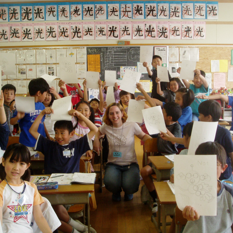 ies abroad intern in a classroom with her students