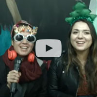 two students singing in sunglasses and tree headband