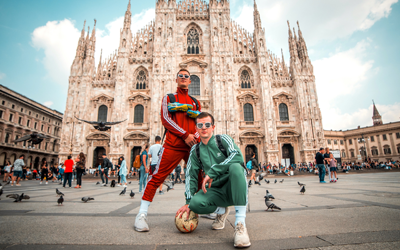 two students posing in front of milan duomo