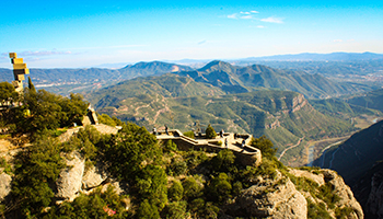 Photo from Montserrat in Barcelona with hills and blue sky