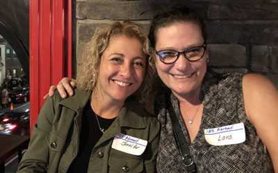 Two alumnae connect at a networking event in New York City