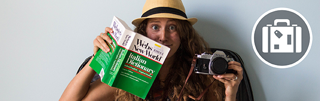 A student with a camera and foreign dictionary