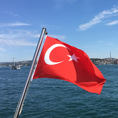 A Turkish flag against the backdrop of the sea.