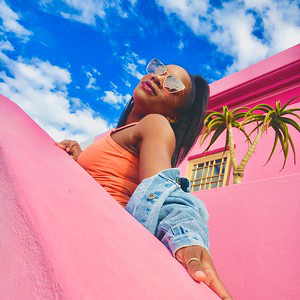 Student against a pink backdrop in Cape Town