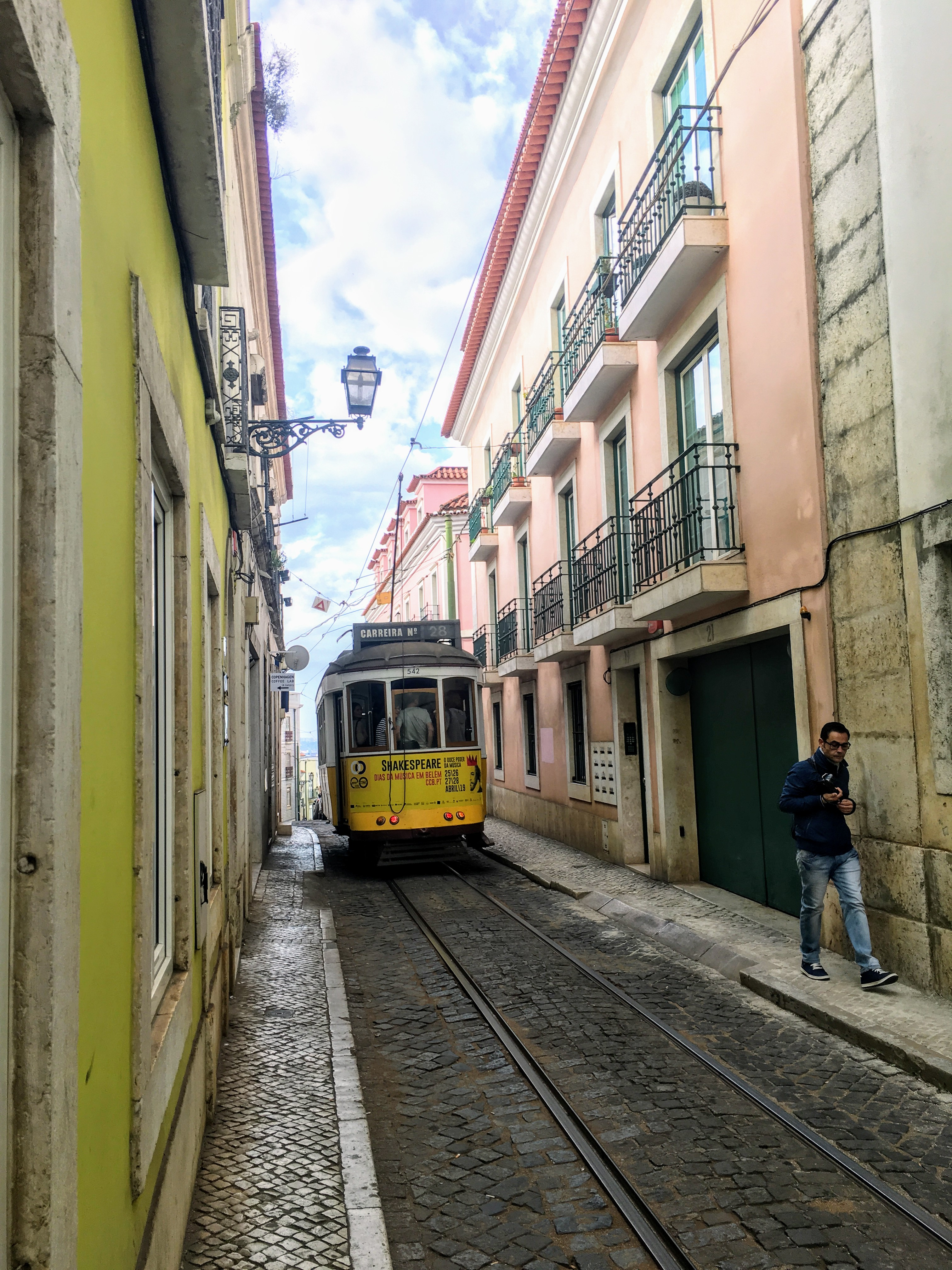 The 28 tram on its way through Alfama