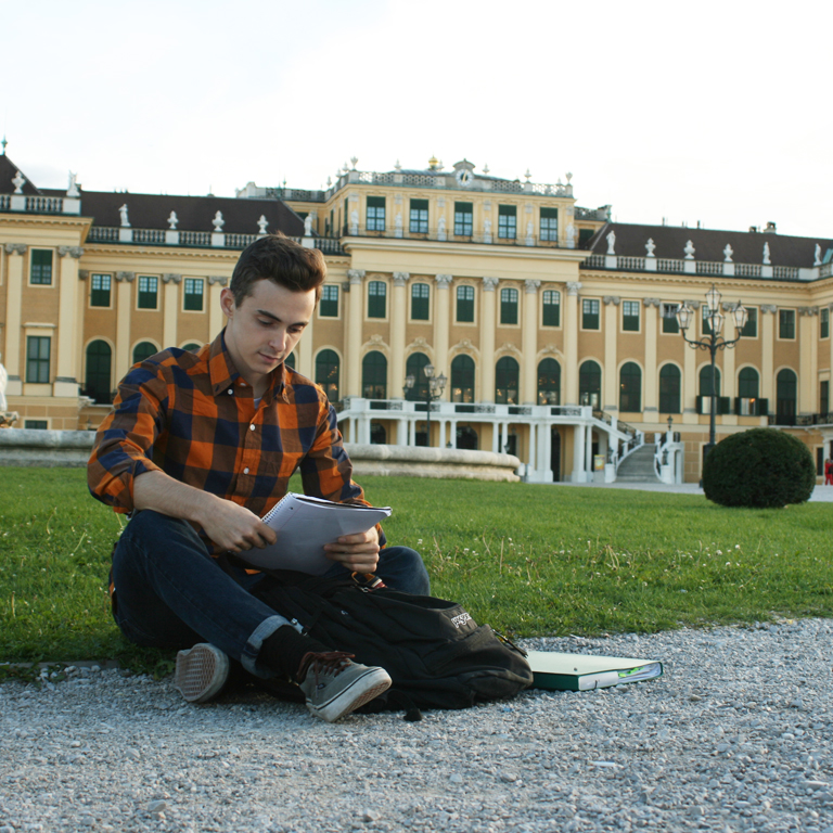 IES abroad vienna student studying in front of a landmark