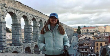 Gaby in front of aqueduct abroad