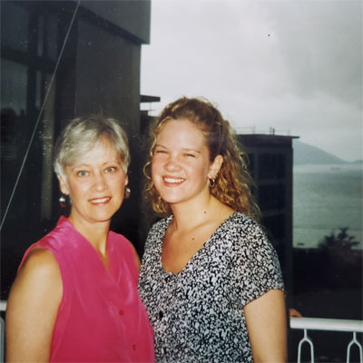 mother in pink top with daughter smiling in hong kong