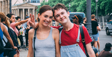two students posing in a crowd in Berlin
