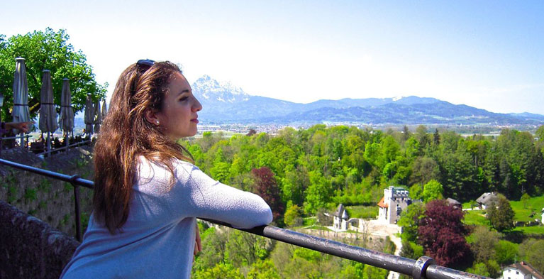 global citizen of the year awardee Ileana Exaras standing overlooking mountain landscape