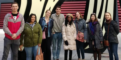 group of study abroad students with amanda gorman in the middle