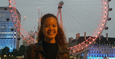 Lydia in front of the London Eye at dusk