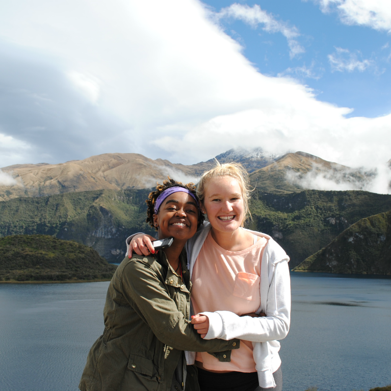 two IES abroad students hugging near a lake in ecuador