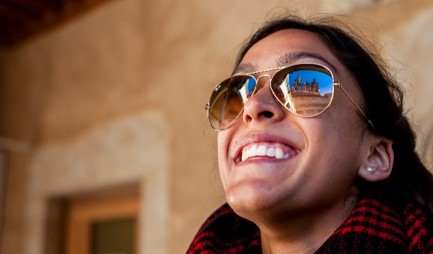 Girl with sunglasses smiling