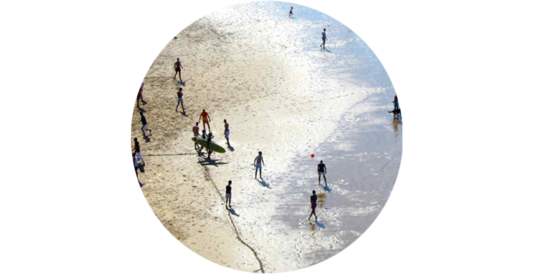 Shoreline at Beach in Rabat, Morocco with people in the water and on the sand