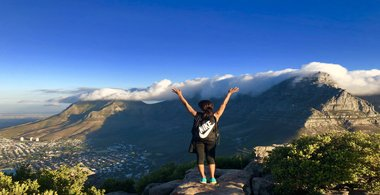 Breana stands at the top of Table Mountain