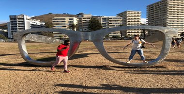 Bruno poses by a pair of giant glasses in Cape Town