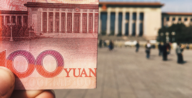 Picture of chinese yuan in front of great hall in Beijing