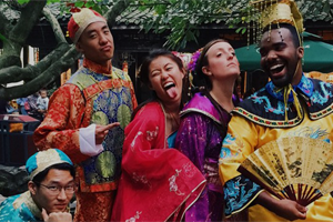 five students in traditional chinese garb in silly poses