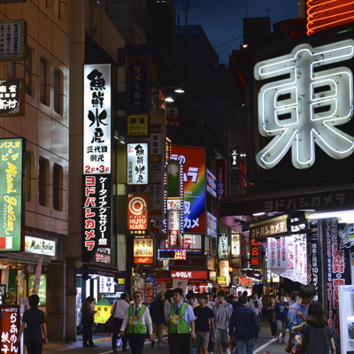 Bright street with colorfully lighted signs in Tokyo at night