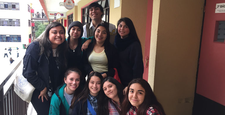 yesenia ayala with students at belen educa in chile